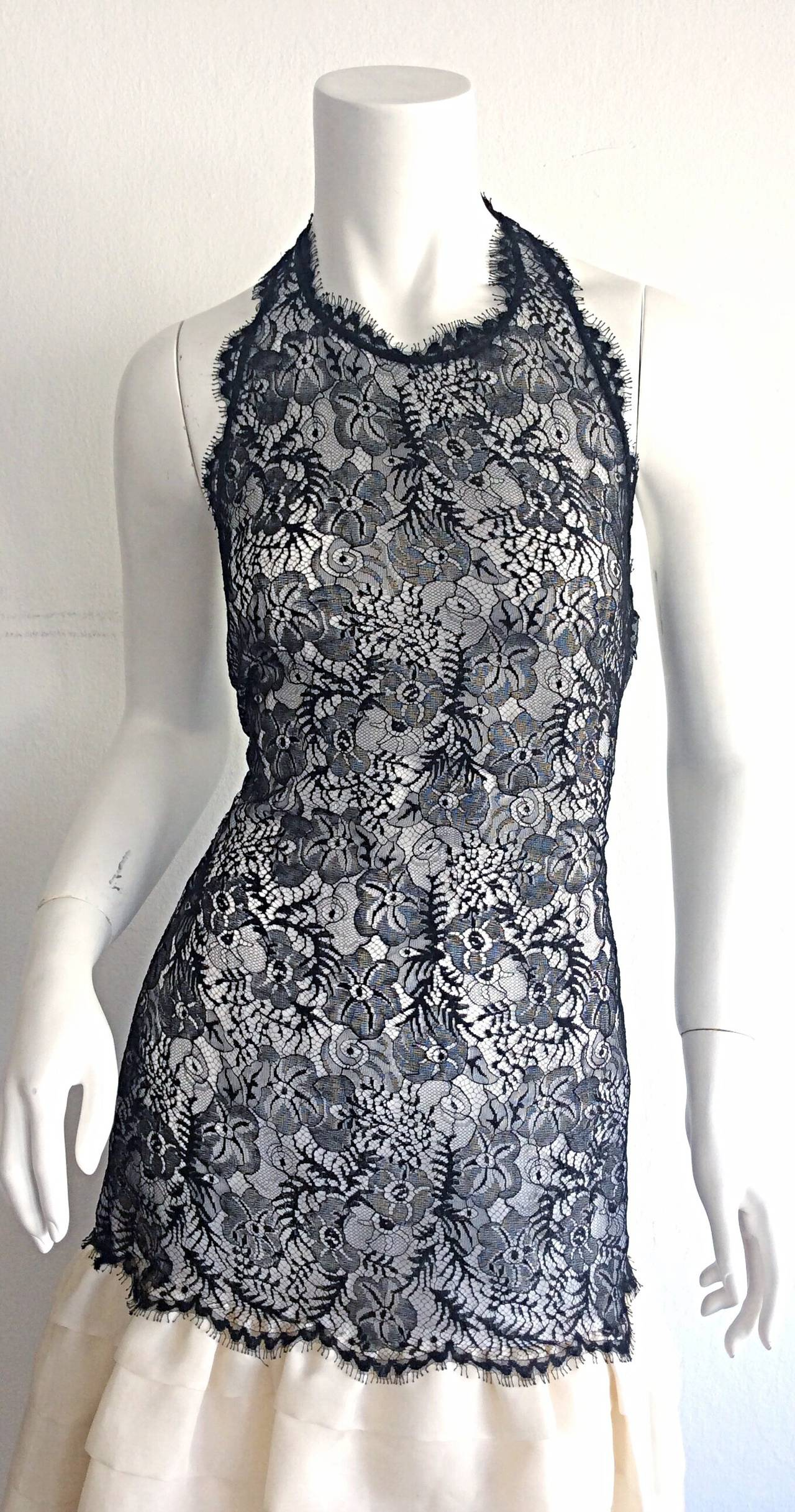 Absolutely stunning vintage Mary McFadden Couture Numbered Dress. This wonderful dress is Demi-Couture, in that it is mostly hand-sewn. Beautiful black French lace on bodice, with extravagant cream taffeta tiered skirt. Avant Garde chiffon bow