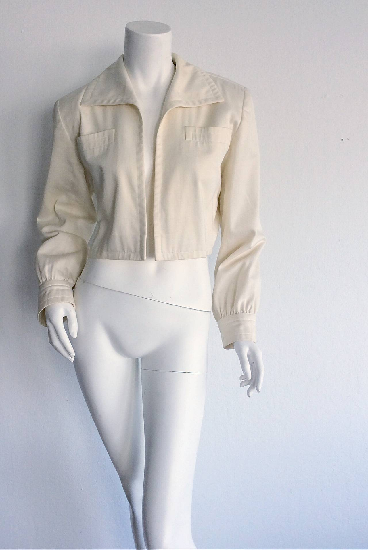 Beautiful vintage YSL 'Rive Gauche' cropped cotton blazer/bolero! Perfect ivory color, with chic long sleeves that look fantastic with sleeves bunched up, and the collar flipped! Easily transitions from day to night. Goes great with jeans, and