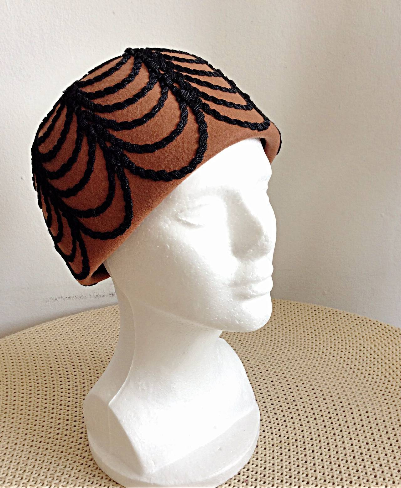 Wonderful rare vintage 1960s Henry Pollak for Glenover felt hat! Dark rust color, with intricate black silk woven detail. In great condition. Approximately Size 7/8  Measures 8 inches by 8 inches