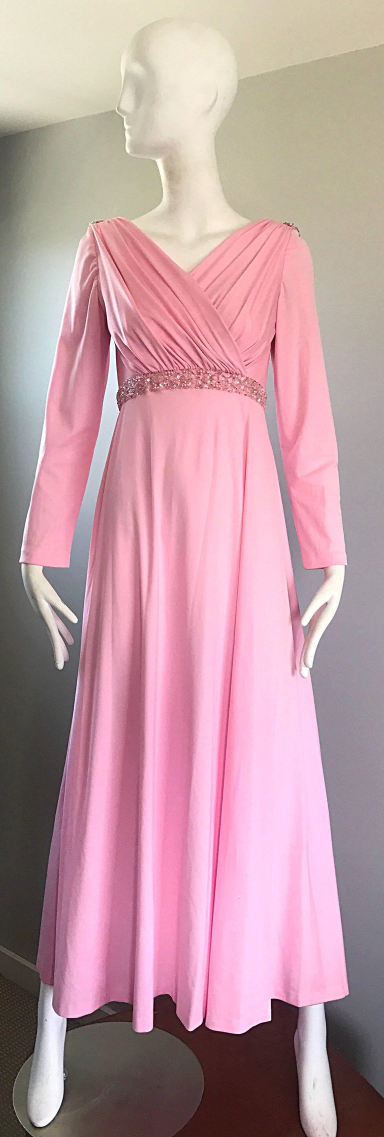 Amazing and gorgeous vintage 70s pale pink sequined and beaded long sleeve jersey gown / maxi dress! Features a pleated tailored bodice, encrusted with hand-sewn sequins and beads at the waist. Draped low cut back is also encrusted with hand-sewn