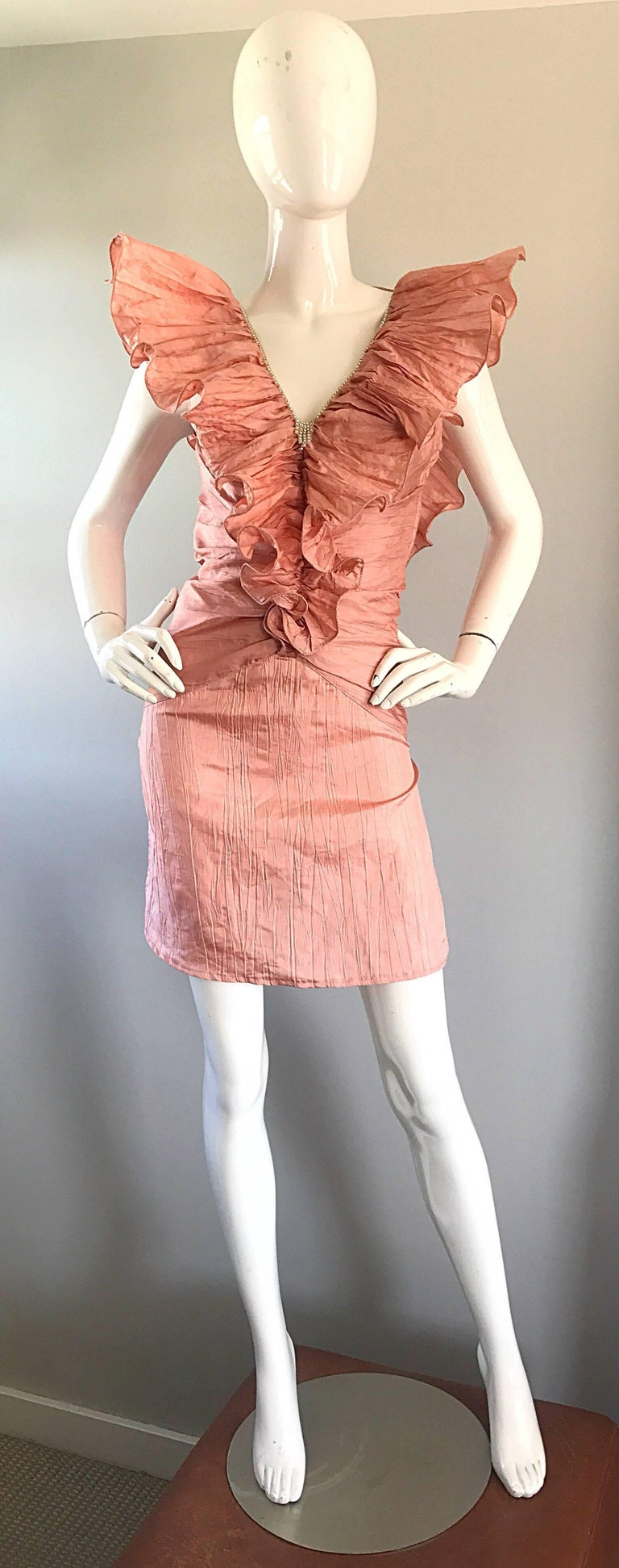 Incredible vintage 1980s AVANT GARDE ruffles and rhinestones sleeveless mini cocktail dress! If this isn't a statement making dress, then I don't know what is! Beautiful pink color is great all year. Ruffles on the front mirror the ones on the low