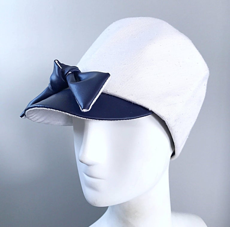 Beyond chic 1960s OLEG CASSINI navy blue and white linen and silk blend nautical hat! The white section features a linen and silk blend that retains its' shape nicely. Navy blue faux leather brim and bow. Looks great with jeans or a dress. In great