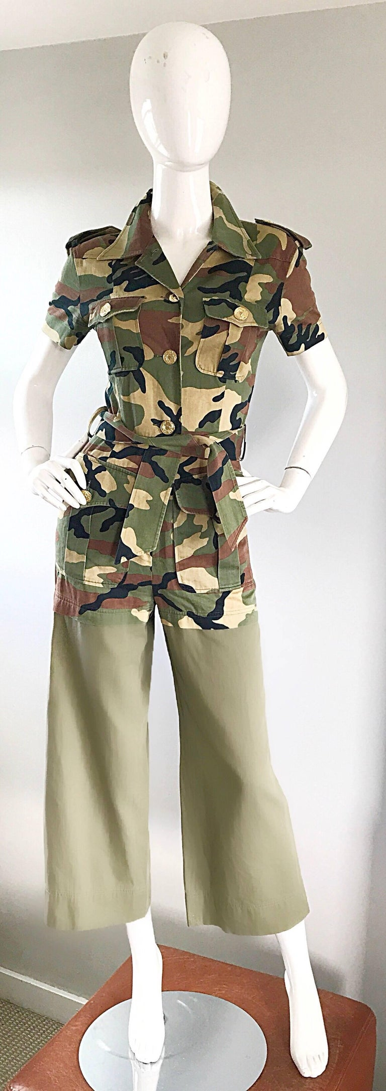Rare vintage MOSCHINO Pret-a-Porter camouflage army green cropped jumpsuit! Features army green, brown, tan, and black camo print throughout. Gold buttons up the bodice, with a zipper fly. Two cargo pockets at each breast, and two cargo pockets at