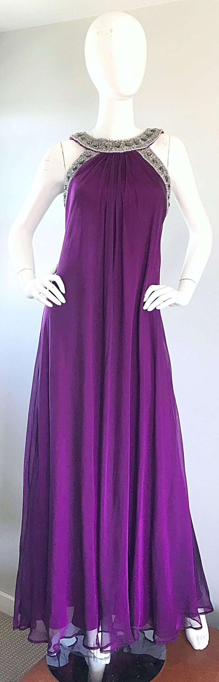 Stunning 90s BADGLEY MISCHKA purple silk chiffon Grecian inspired empire shaped evening dress! Features hundreds of hand-sewn rhinestones and silver beads along the neck and arms. Layers of luxurious silk chiffon look amazing on! Hidden zipper up