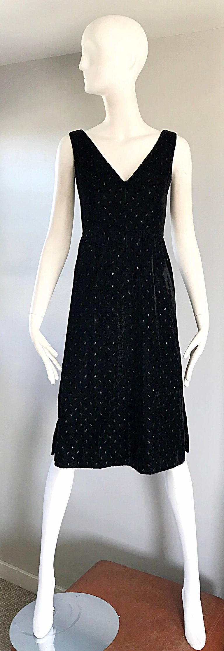 Beautiful 1960s ANDRE COURREGES black velvet A-line metallic dress! Luxurious lightweight black velvet, with metallic sparkles scattered throughout. Slits on each side of the hem. Fully lined. Couture quality one would expect from this hard to find