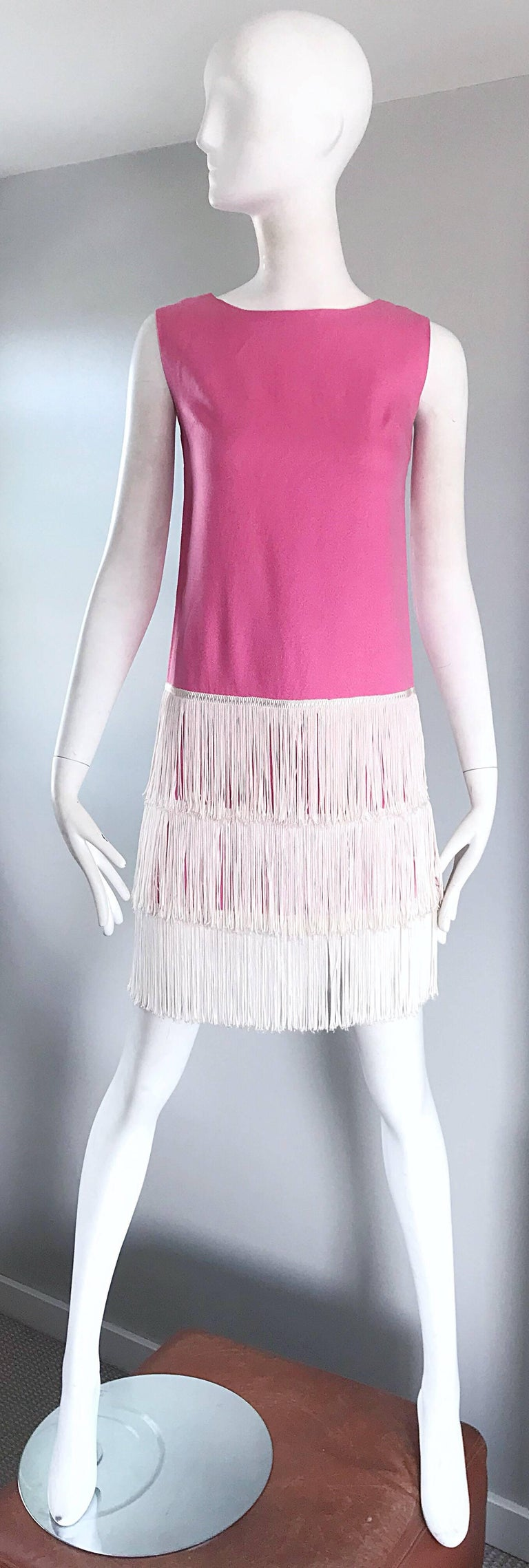Amazing 60s does 20 bubblegum pink and white sleeveless flapper style fringed flapper style shift dress! Soft textured cotton, with three tiers of white fringe at the hem. Full metal zipper up the back with hook-and-eye closure. Very well made, with