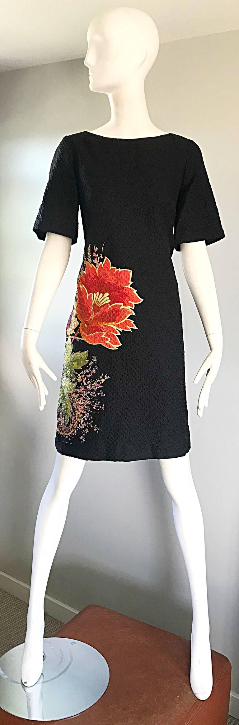 Chic 1990s ETRO short bell sleeve textured silk shift sac dress with POCKETS! Features a jet black background, with a colorful flower print in red, pink, yellow, purple and green on the side front and back. Hidden zipper up the back with