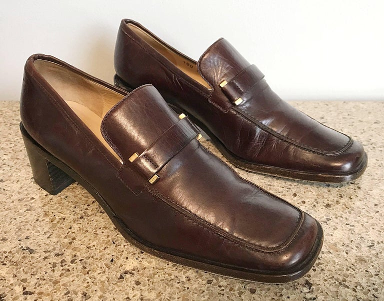 Classic pair of vintage Gucci leather stacked heel loafers from Tom Ford's first collection with Gucci in 1996! Rich chocolate color pairs nicely with nearly everything. Brass hardware. These 90s gems can easily be dressed up or down. Great with