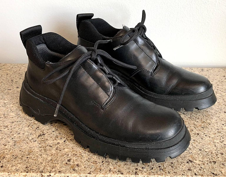 New 1990s Prada Black Leather Size 37.5 / 7.5 Chunky Vintage Flat Ankle Boots In New Condition For Sale In Chicago, IL