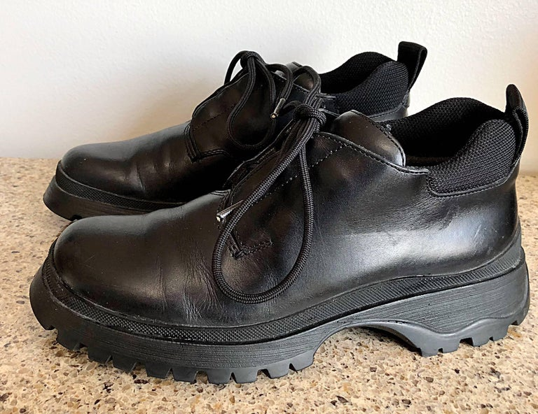 New 1990s Prada Black Leather Size 37.5 / 7.5 Chunky Vintage Flat Ankle Boots For Sale 1
