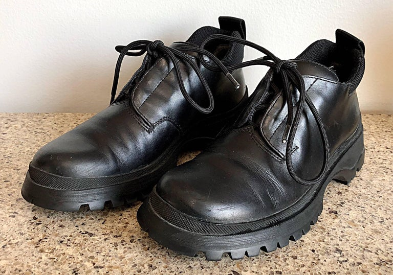 New 1990s Prada Black Leather Size 37.5 / 7.5 Chunky Vintage Flat Ankle Boots For Sale 2