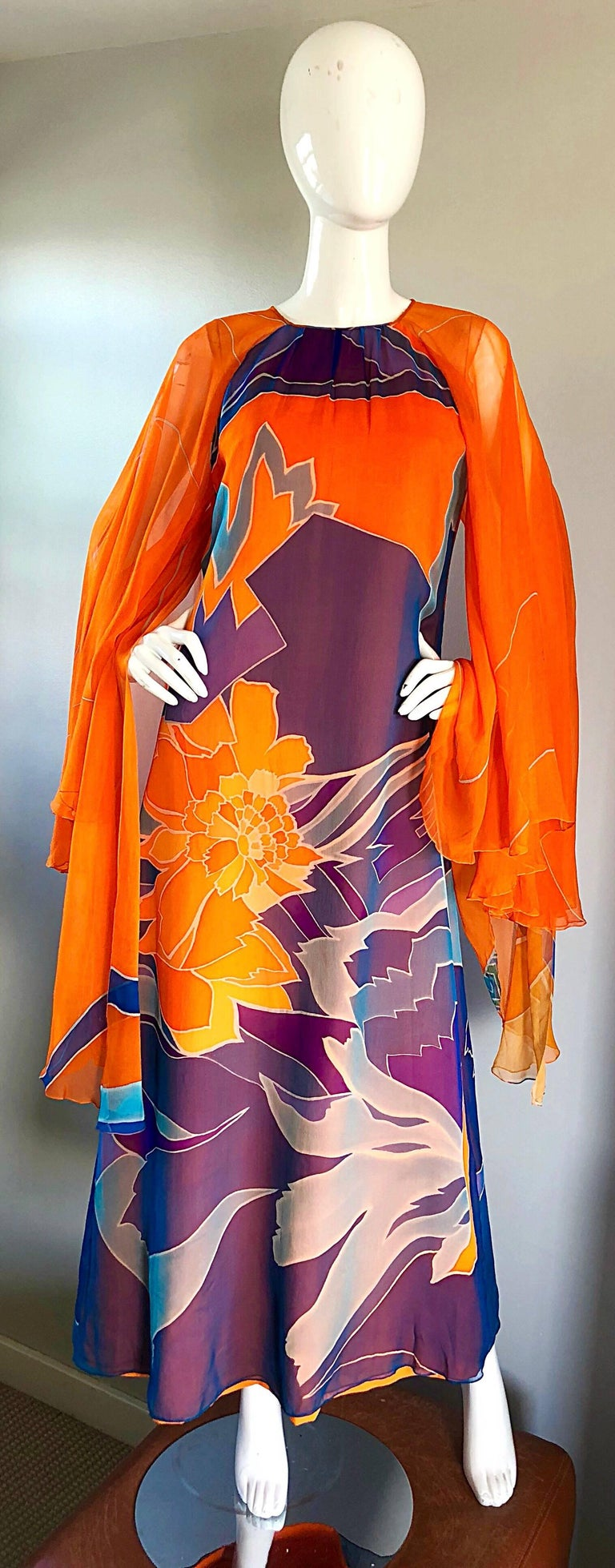 Sensational vintage 70s HANAE MORI COUTURE bright orange silk chiffon kaftan maxi dress! Features incredible dramatic wide angel wing sleeves, with layers and layers of semi sheer chiffon. Vibrant abstract prints in bright orange, purple, blue,