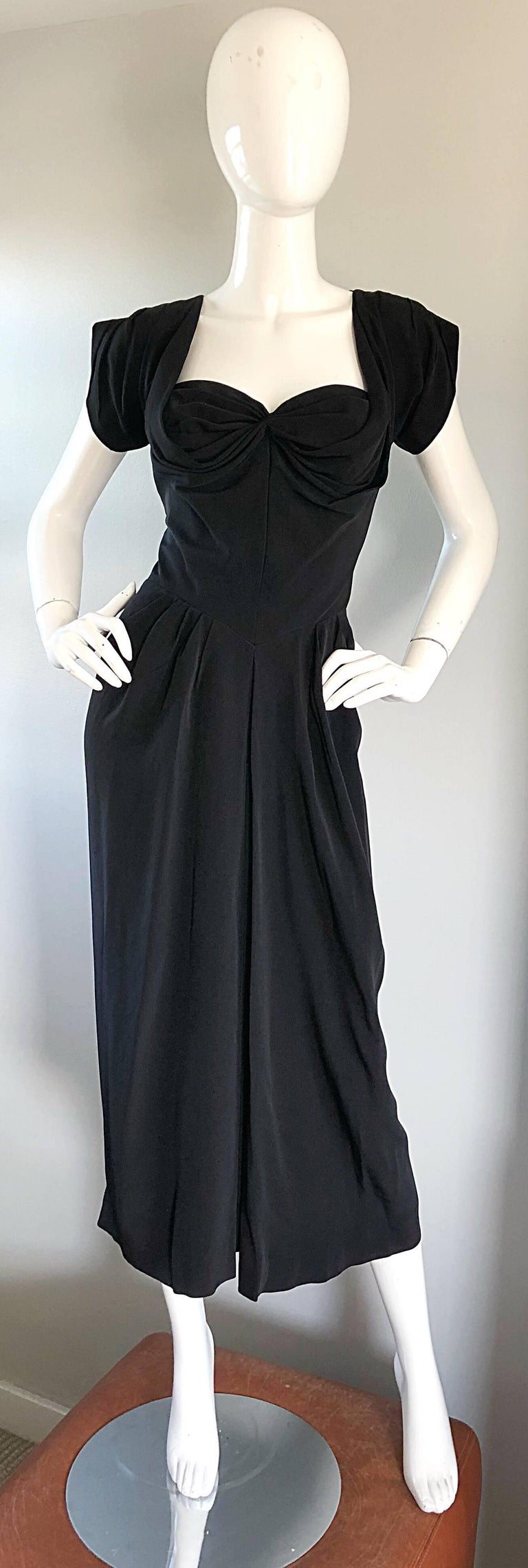 Gorgeous, classic, and just the right amount of sexy 1950s DOROTHY O'HARA demi couture black silk crepe dress! Dorthy O'Hara was a leading designer of the 40s and 50s. She was a favorite go to for Marilyn Monroe, Jayne Mansfield, Sophia Loren, etc.