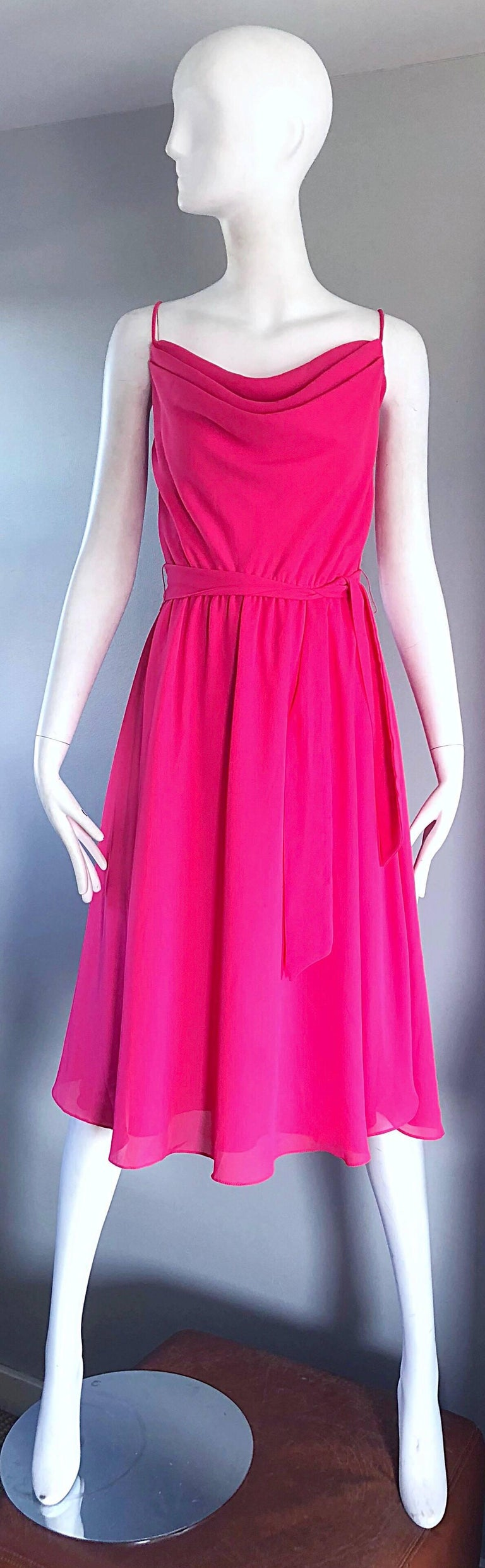 Gorgeous vintage 70s PHILLIPE JODUR for FERRALI schocking hot pink sleeveless crepe disco dress! Features a fitted draped Grecian style bodice. Flirty full skirt, with a detachable tie belt. Simply slips over the head, and stretches to fit. Features