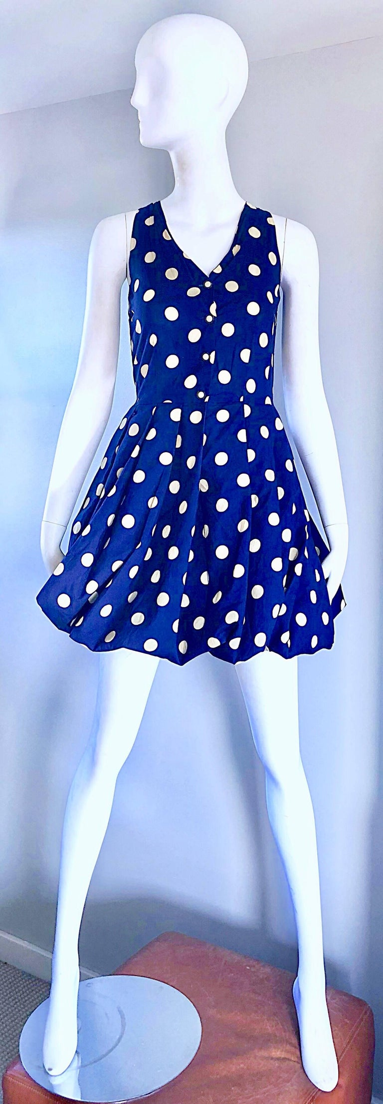 Chic 1990s SERGIO TEGON for SEVENTY navy blue and ivory white polka dot cotton sleeveless mini bubble dress! Features a fitted bodice that buttons up the front, with a full bubble skirt. Navy blue and ivory white polka dots throughout. Interior band