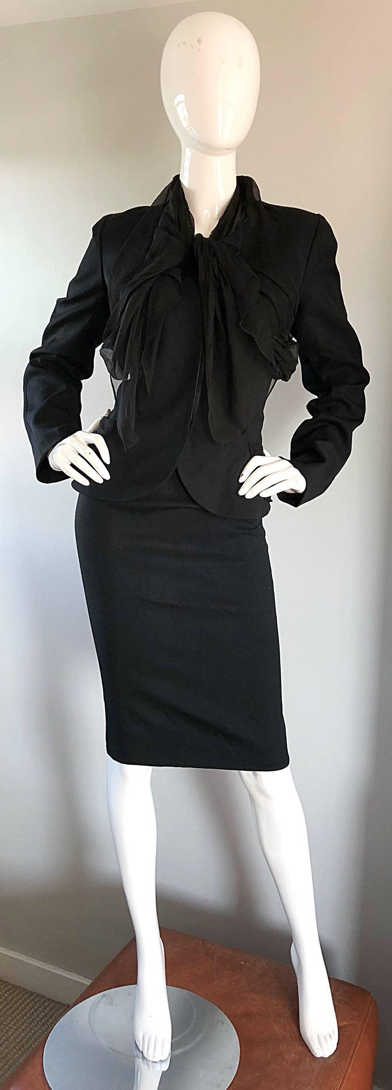Chic early 2000s Does 40s black JOHN GALLIANO virgin wool and silk chiffon skirt suit! Features a soft black virgin wool, with Avant Garde black silk chiffon Bonnie and Clyde detail at neck and waist. Hidden buttons up the front blazer bodice. High