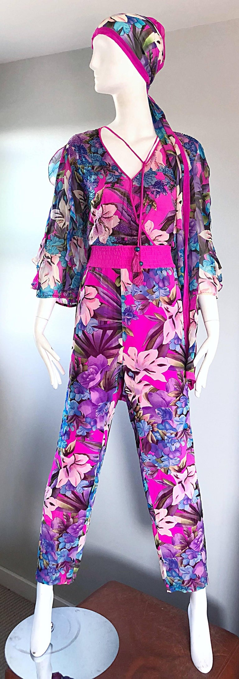 Amazing vintage DIANE FREIS silk chiffon beaded jumpsuit! Features vibrant colors of pink, purple and blue in a chic floral print throughout. Hundreds of hand-sewn seed beads on the bodice. Inner hidden snap at bust allows to control cleavage