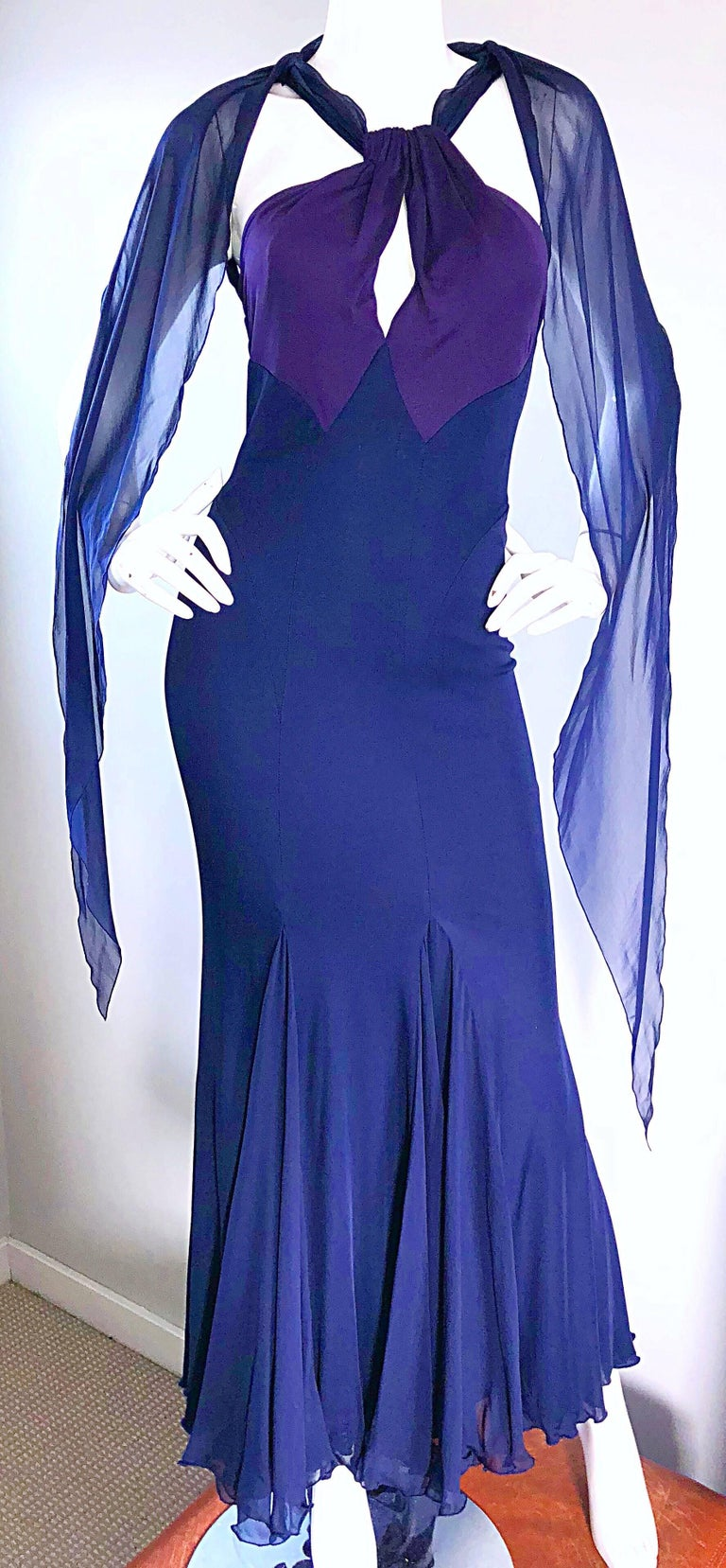 Gorgeous 1990s / 90s BILL BLASS original sample grecian inspired color block evening dress! Features a slinky silk jersey that stretches to fit. Purple bodice, with keyhole cut-out at center bust, and navy skirt. Navy blue chiffon ties at the back