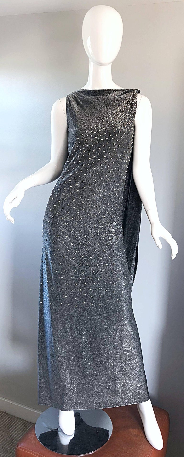 Rare Musuem Worthy 60s GEOFFREY BEENE Couture gunmetal + silver metallic silk lurex caped evening dress! Luxurioussoft (not scratchy at all) silk lurex fabric. Features hundreds of hand-sewn silver metal studs and rhinestones on the front. Attached