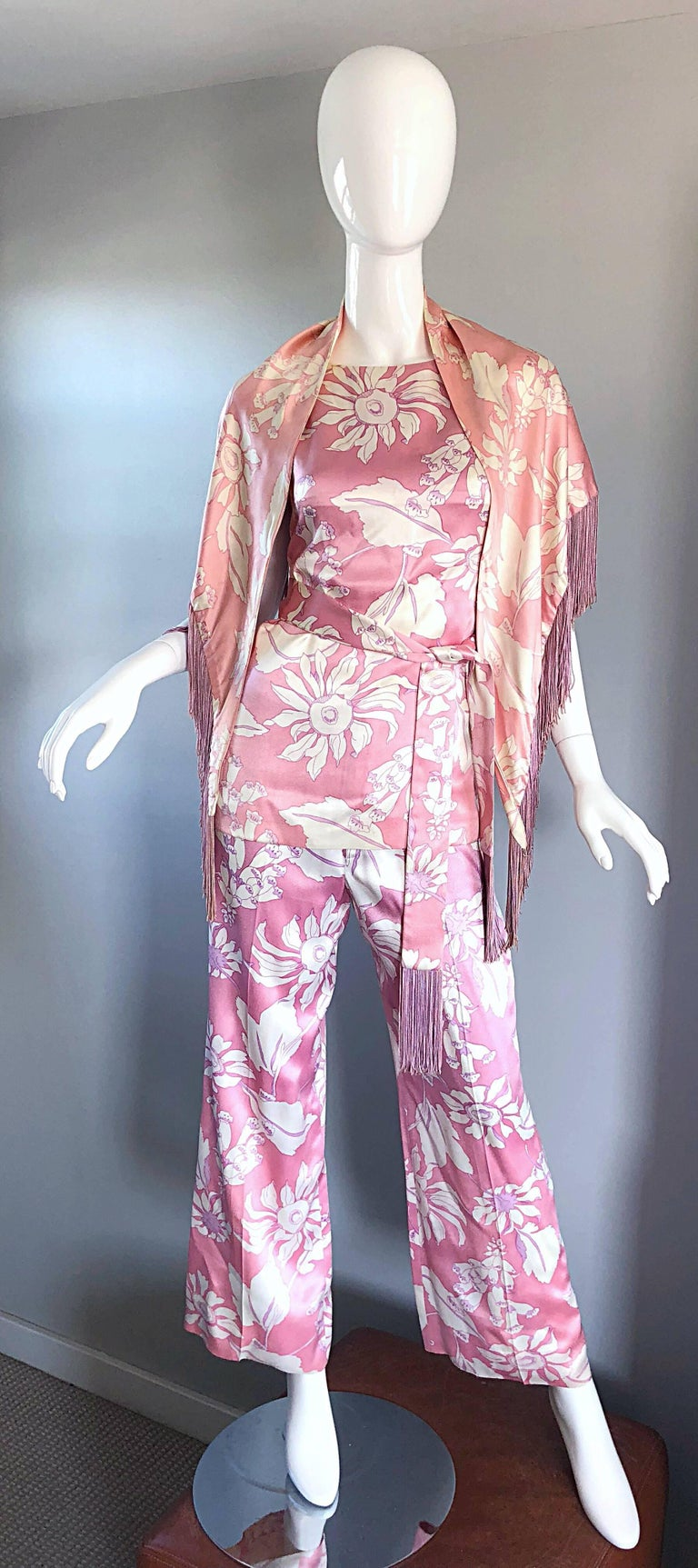 Gorgeous 70s GEOFFREY BEENE four piece silk ensemble! Features a pale pink and white abstract floral print on each piece. Shawl purposely has matching light pink and ivory to off-set the ensemble. Sleeveless shell style blouse, with mid-rise wide