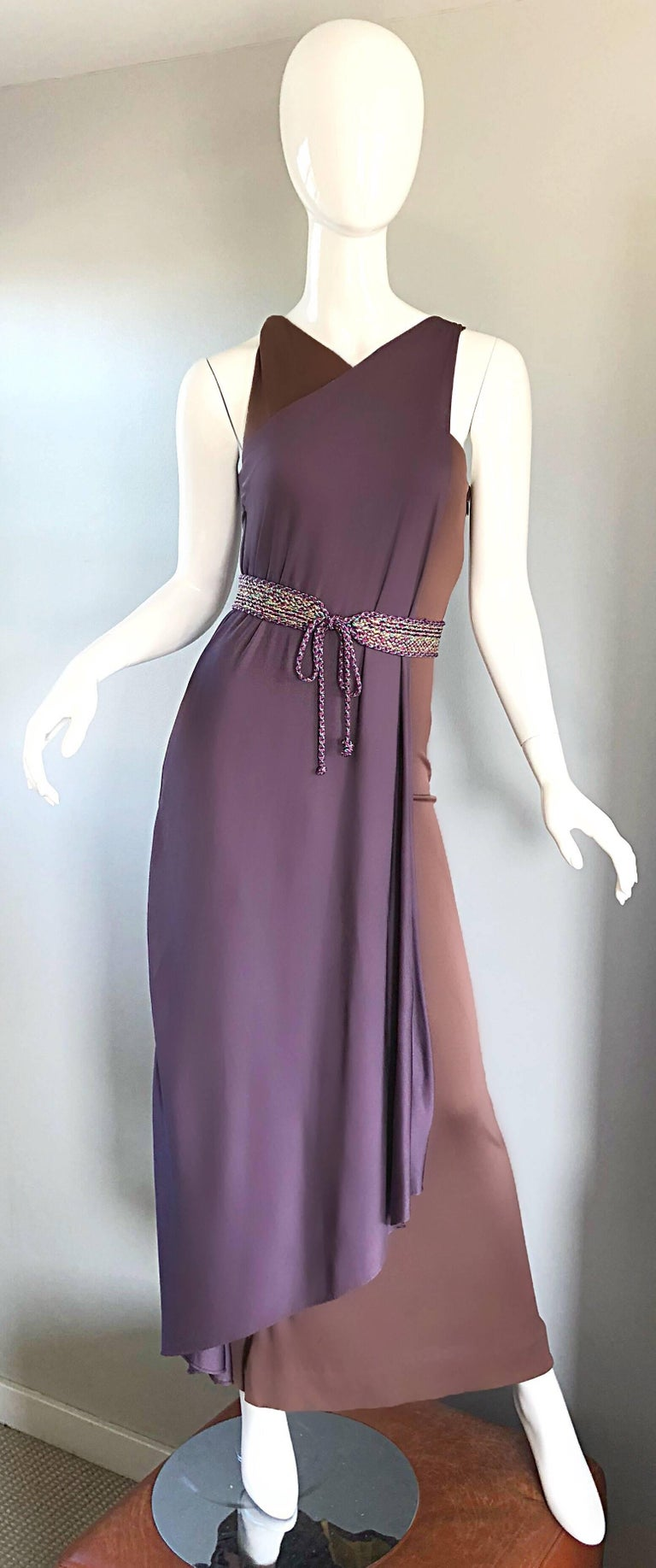 Gorgeous 70s BILL BLASS purple and brown silk jersey Avant Garde Grecian inspired color block belted evening dress! Slinky silk jersey fabric hugs the body in all the right places, and allows for plenty of stretch. Brown body, with a purple overlay.