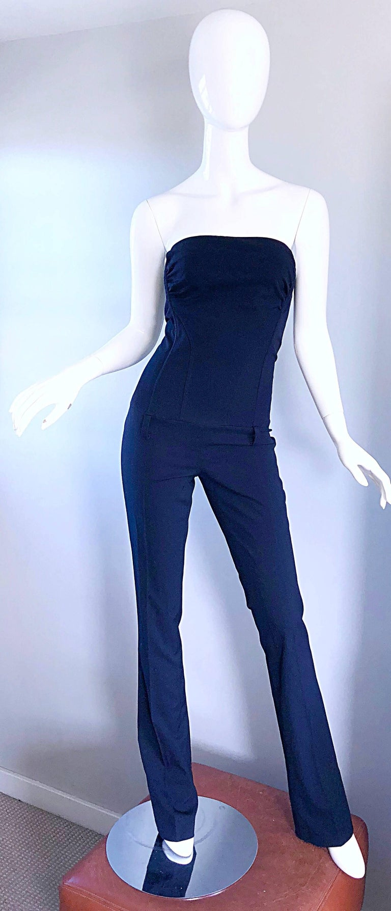 Fantastic early 2000s ELISABETTA FRANCHI Per CELYN B. Navy blue strapless jumpsuit! Features a soft virgin wool and rayon blend that allows for just the right amount of stretch and comfort. Boned bodice keeps everything in place. Pant legs are