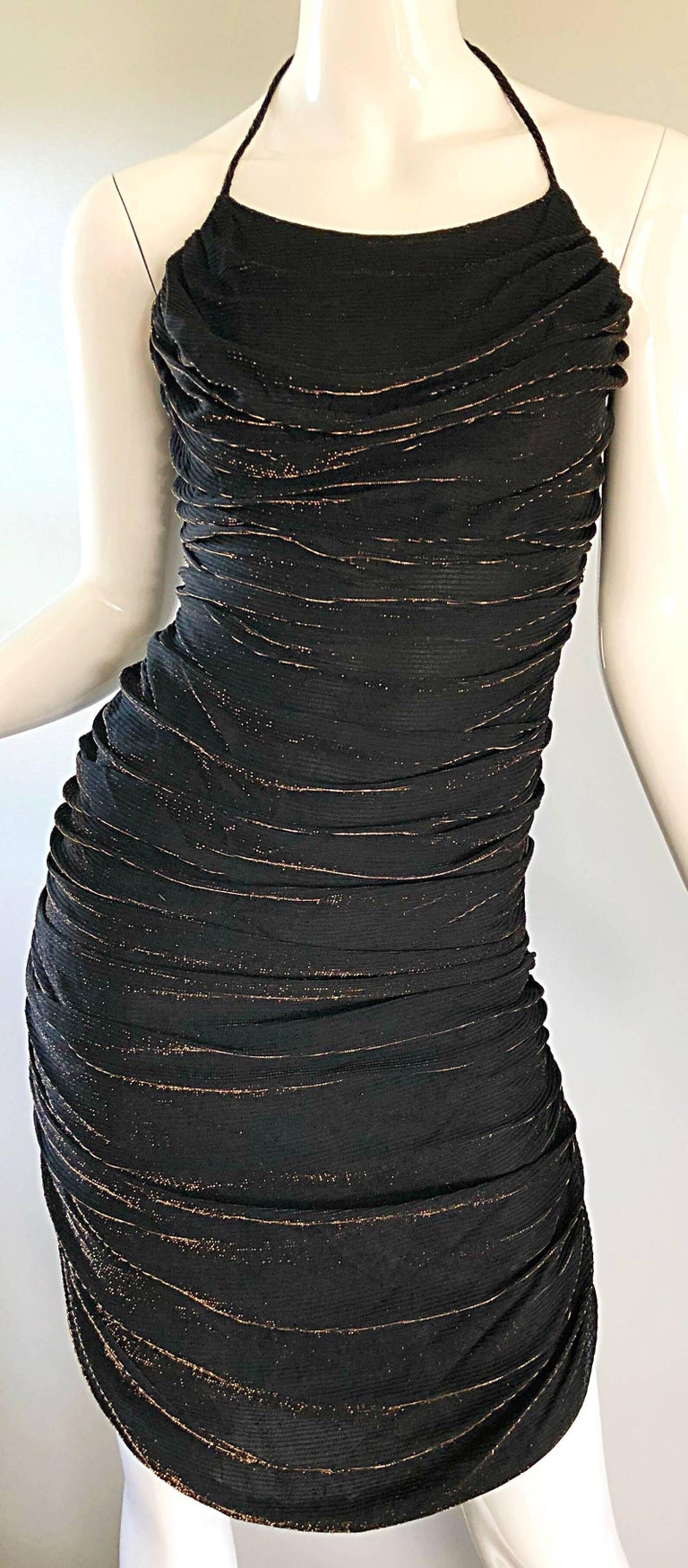 Sexy 1970s SAMIR black and bronze metallic ruched halter dress! Features flattering ruching body that stretches to fit. Body hugging fit looks fantastic on! Hidden zipper up the side. Lots of attention to detail. Great Studio 54 disco party dress,