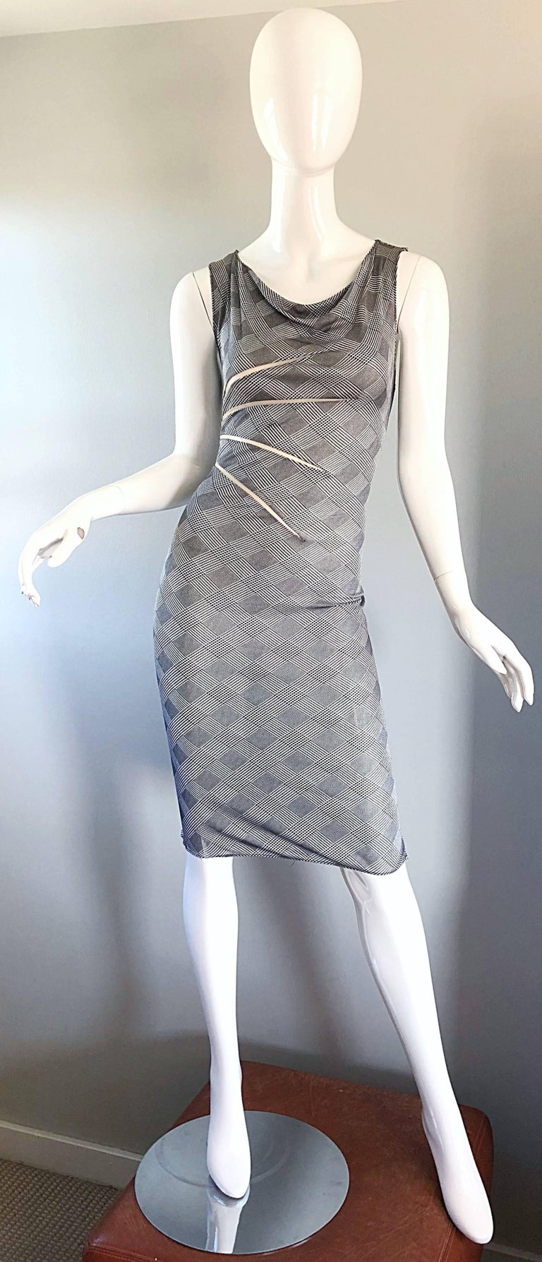 Rare and collectible vintage GIANNI VERSACE COUTURE  Spring / Summer 1998 black and white houndstooth dress! Sheer cut-out details at the side bodice on the front and back of this 1990s dress. Features a body hugging silk jersey that stretches to