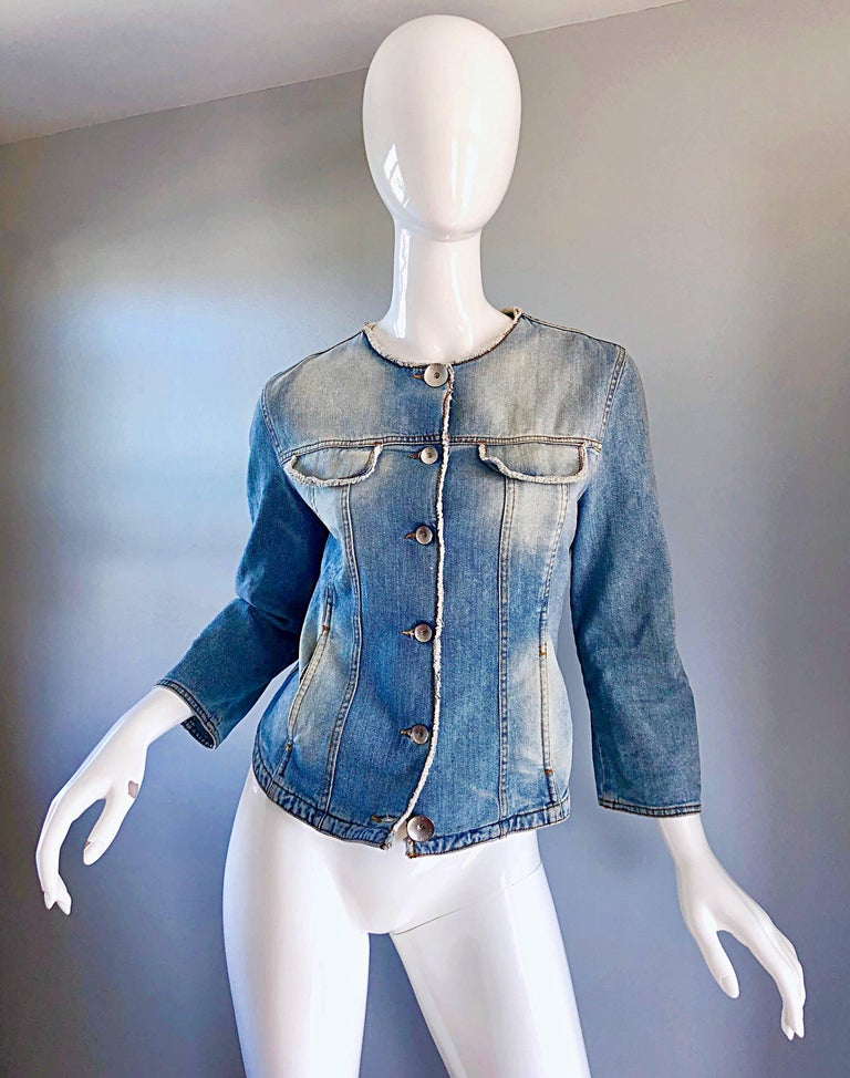 Amazingly chic vintage early 90s KRIZIA blue jean 'glitter' moto jacket! Features a light blue sandblasted denim, with an allover glitter coating (hard to see in photos, but amazing in person). Large matte silver nickel logo embossed buttons up the