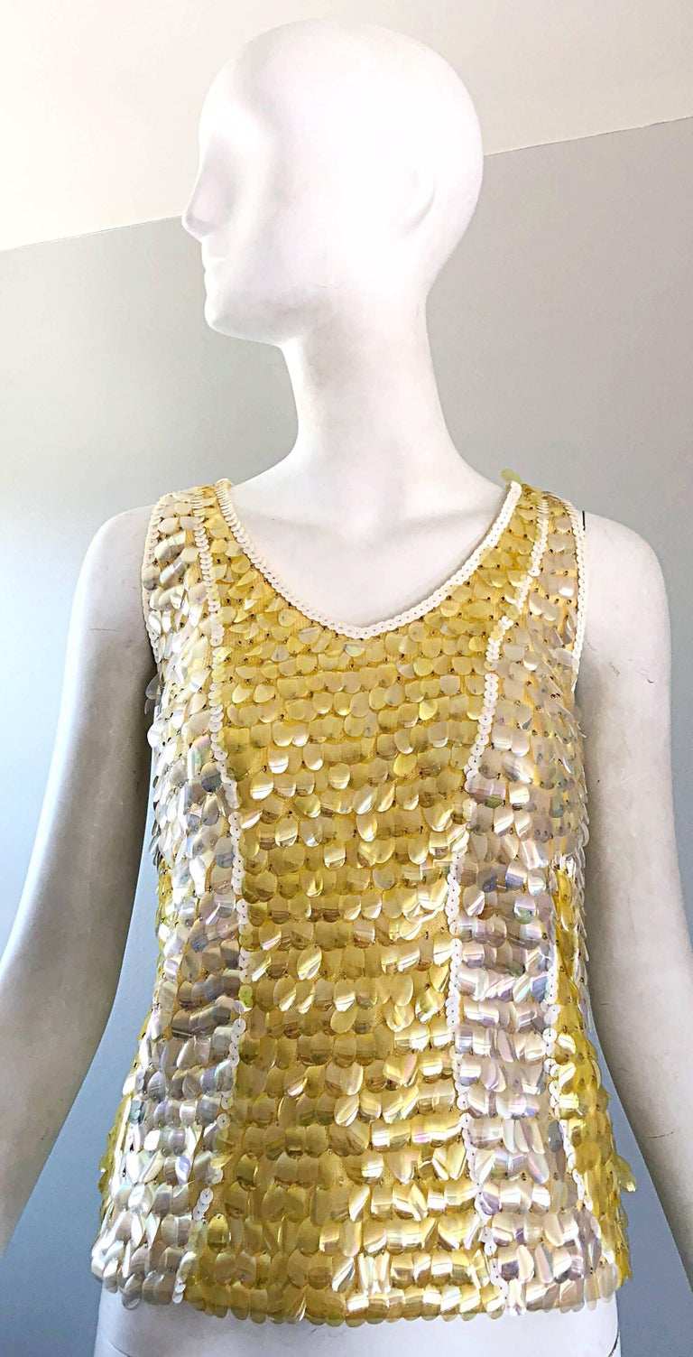 Chic vintage 1960s yellow, white and clear paillettes and sequin encrusted sleeveless lamb's wool sweater top! Features hundreds of hand-sewn sequins and paillettes throughout. Super soft luxurious lamb's wool, and fully lined in rayon. Full metal