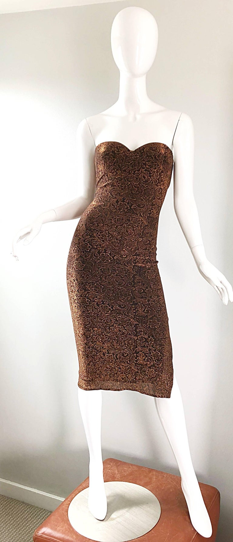 Sexy 90s does 50s vintage ELETRA CASADEI metallic bronze / copper bodycon convertible strap wiggle dress! Dress can be worn with attached adjustable black straps, or as a strapless dress with straps simply tucked in. Stretch bronze jersey fabric