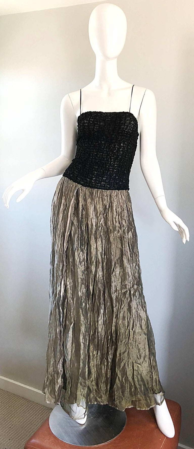 Stunning 1990s MORGANE LE FAY black and gold ombre metallic evening gown! Features a spaghetti strap semi sheer bodice that stretches to fit. Panels of gold / bronze ombre crinkled silk skirt with a black underlay. Looks phenomenal on. THe pictured