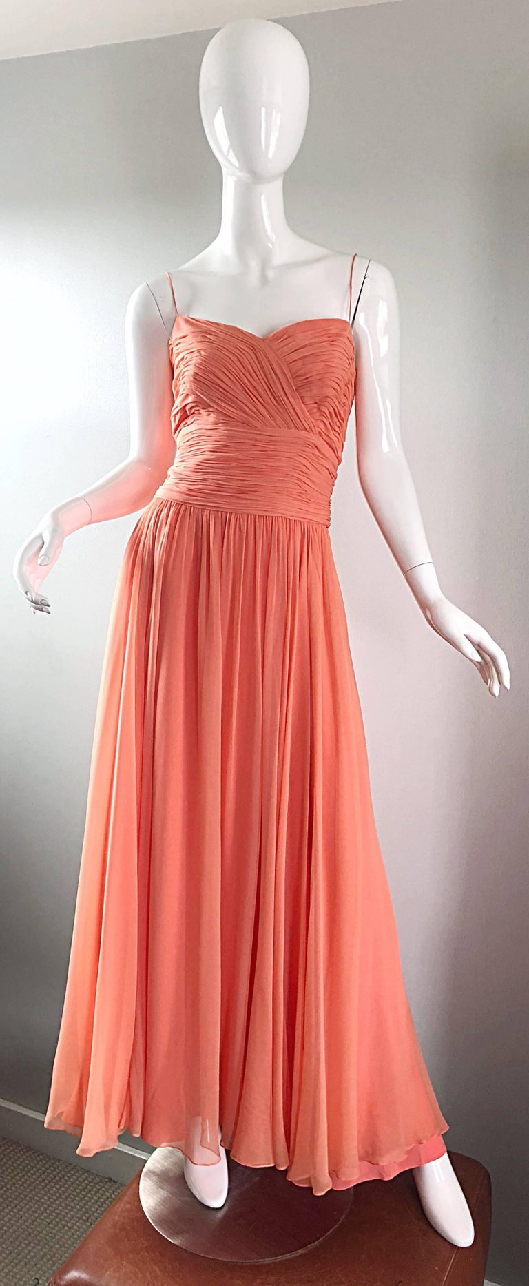 Gorgeous 1950s SAKS 5th AVENUE salmon, coral pink silk chiffon demi couture gown! Words cannot even begin to describe the quality, construction, color and design of this masterpiece! Flattering ruched bodice with thin spaghetti straps. Layers and