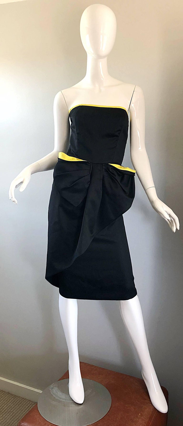 Chic late 80s VICTOR COSTA black and yellow Avant Garde strapless cotton cocktail dress! Features a fitted boned bodice that is lined in canary yellow. Forgiving skirt features a large  bow-like detail. Hidden zipper up the back with hook-and-eye