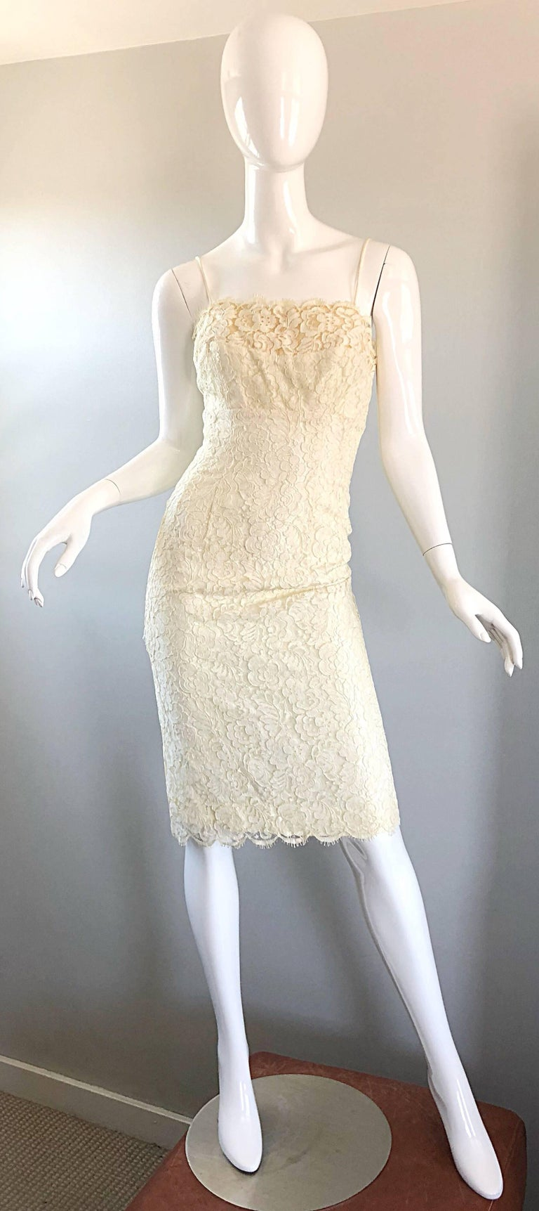 Beautiful 1950s LILLI DIAMOND ivory French lace wiggle dress! Wonderful fit hugs the body in all the right places, and was constructed to really flattering the body. Nude illusion detail above the bust. Spaghetti strap sleeves can also be tucked in