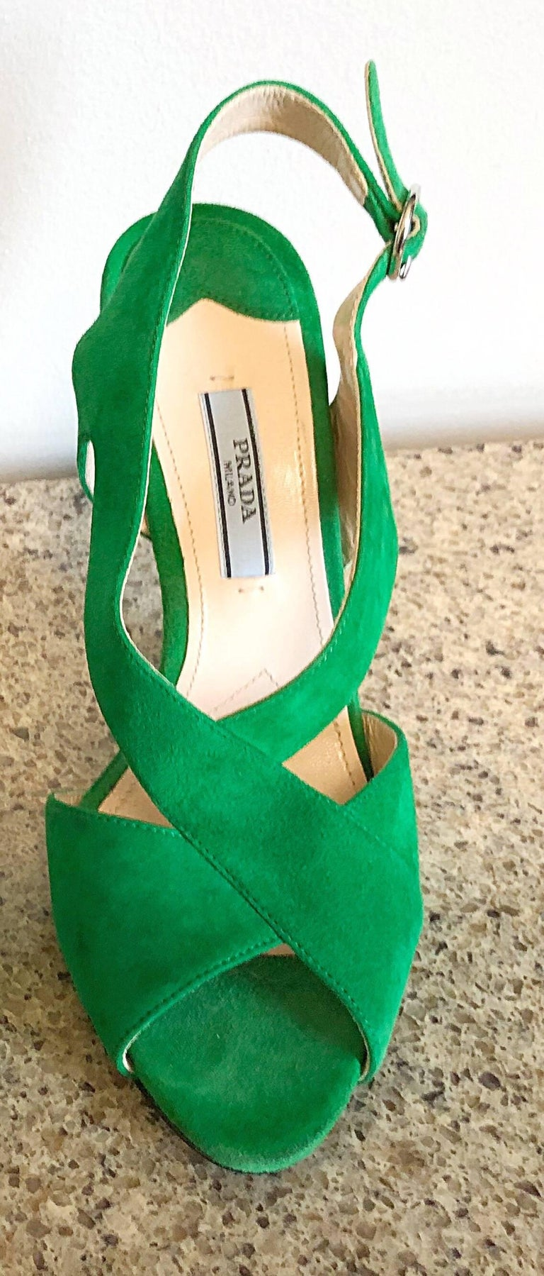 Fabulous brand new PRADA kelly green runway open toe heels! Vibrant green color on an architecturally appealing design. Adjustable strap can fit an array of ankle sizes. Extremely comfortable shoes that are easy to wear all day. The perfect pop of