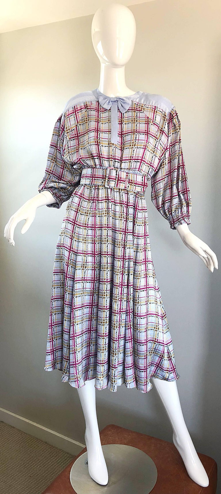 Beautiful 1980s DIANE FREIS belted dress! Classic Freis silhouette is super easy and comfortable to wear, without sacrificing style. Soft pastel shades of purple and pink, with just a bit of yellow. Hidden buttons up the front neck with a chic bow