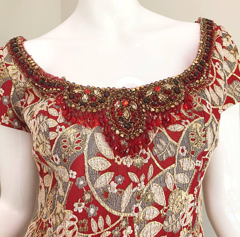 Gorgeous vintage 1960s MONTALDOS red and gold silk brocade beaded evening gown and full length jacket! The luxurious fabric is made of red and metallic gold silk brocade. The dress features hundreds of hand-sewn ruby red rhinestones, crystals and