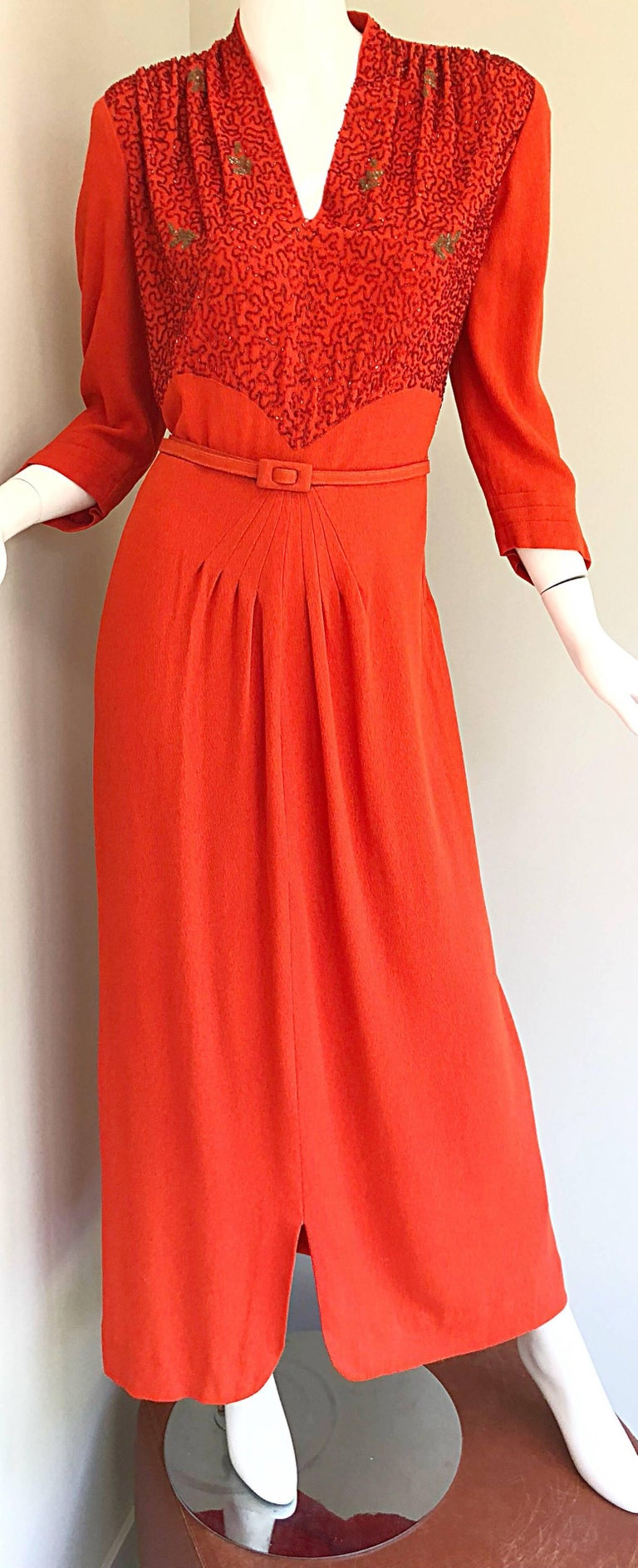 Beautifully perfected KORNHAUSER 1940s burnt orange crepe rayon beaded evening dress! Warm burnt orange color, with thousands of hand-sewn beads, sequins and rhinestones on the front bodice, which really flatters the stomach area. Full metal zipper