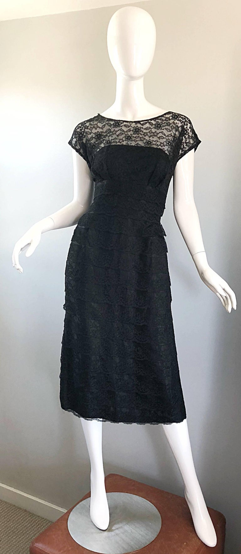 Chic 1950s black French lace cocktail dress! Features luxurious black French lace, with a fitted bodice and flattering forgiving skirt. Full metal zipper with hook-and-eye closure. Couture quality, with heavy attention to detail. The perfect classic