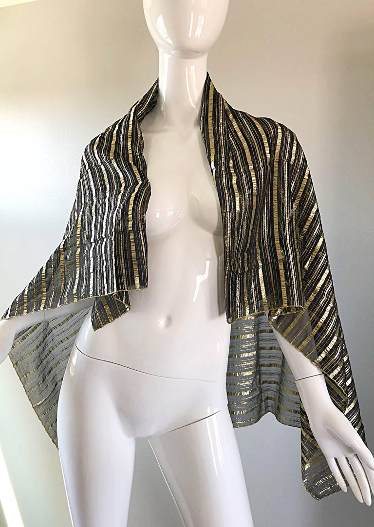 Beautiful vintage CHRISTIAN DIOR large gold and black silk metallic piano shawl scarf! Features gold and black metallic stripes throughout. Can be worn a number of different ways. Glamorous draped over the shoulders, or thrown over the neck. In