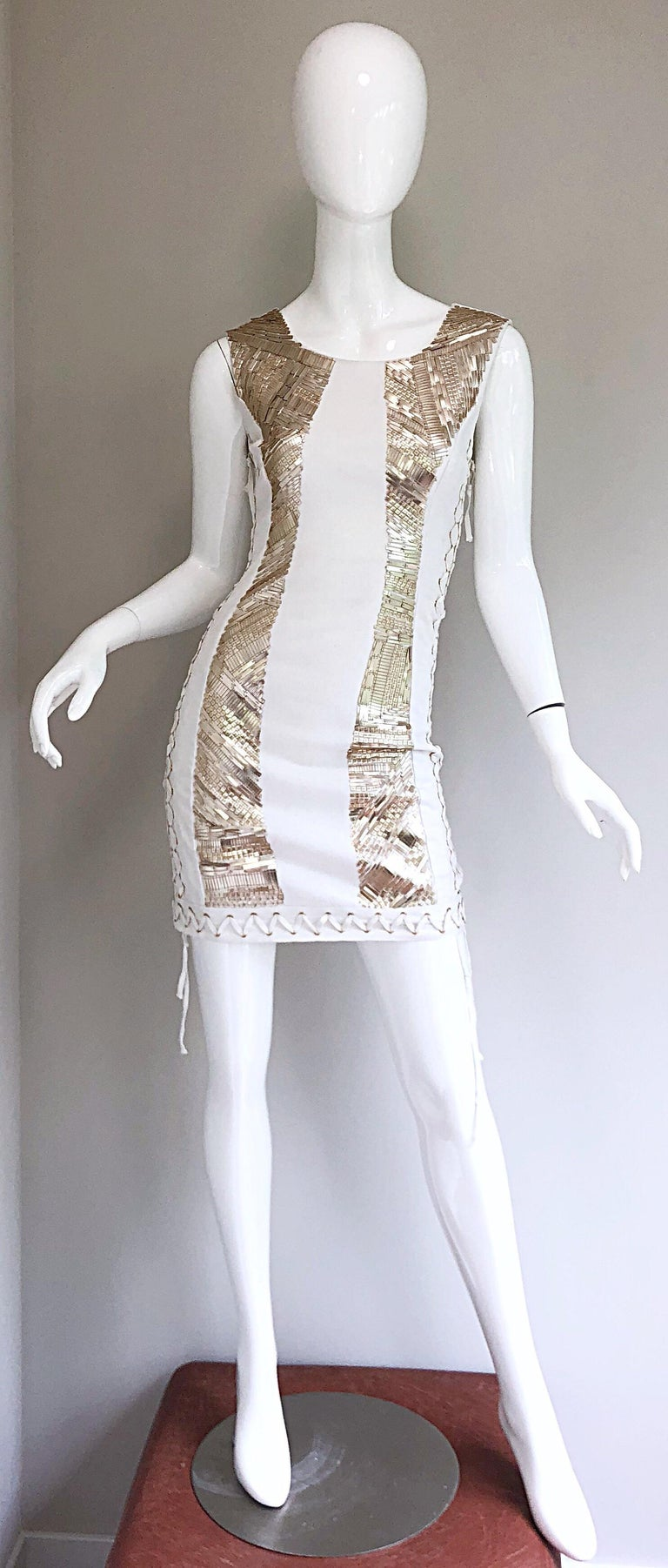 Sexy new with original store tags PIERRE BALMAIN white and gold sequined lace-up mini dress! Features thousands of muted gold rectangle sequin beads o each side of the front. Sturdy cotton (95%) and elastane (5%) fabric is flattering, comfortable,