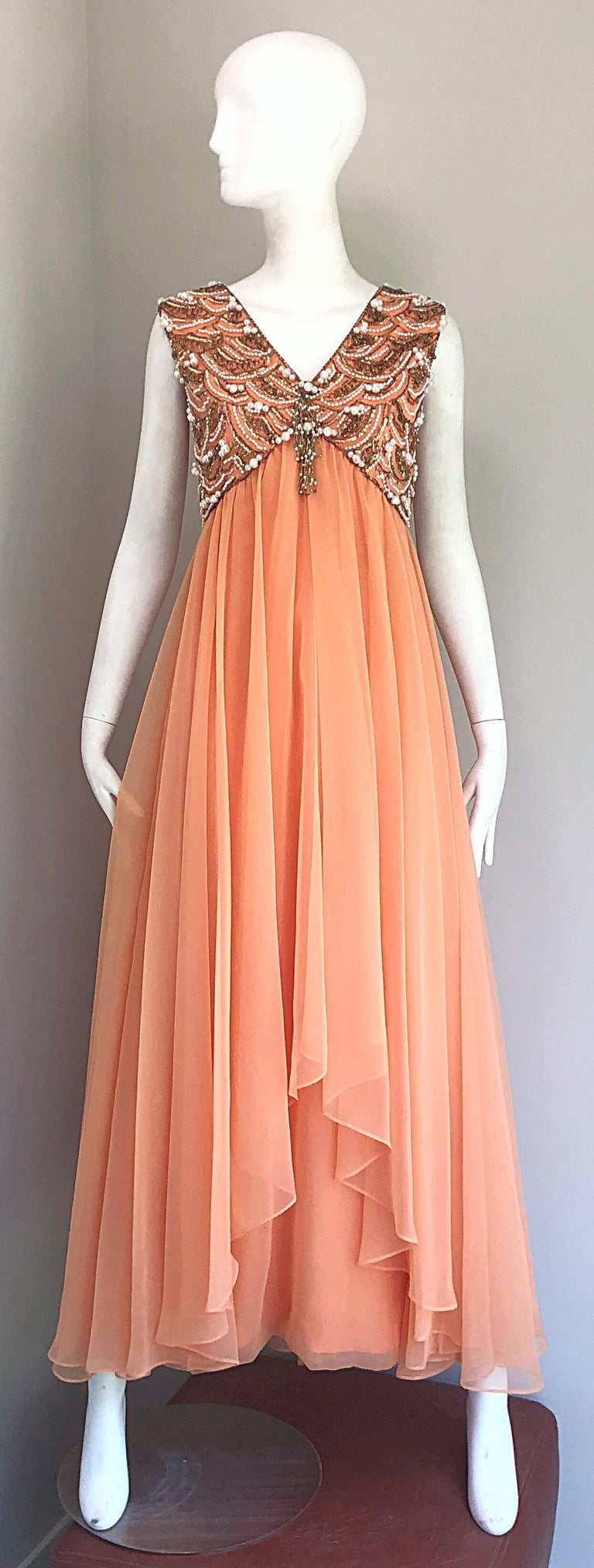 Stunning vintage 60s ISABELL GERHART of Houston  sherbet / coral pink colored chiffon beaded sleeveless evening gown! Fitted beaded bodice, with layers and layers of luxurious chiffon that form a free flowing casculating hem at front center and