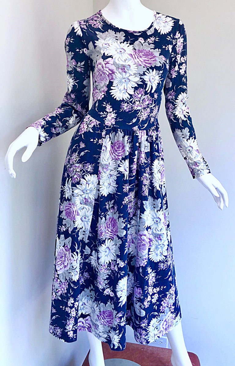 Chic classic early 1990s LAURA ASHLEY navy blue, purple and gray flower print long sleeve cotton dress! Features a fitted bodice with a flattering and forgiving full midi skirt. POCKETS at each side of the hips. Button closure at top back neck.