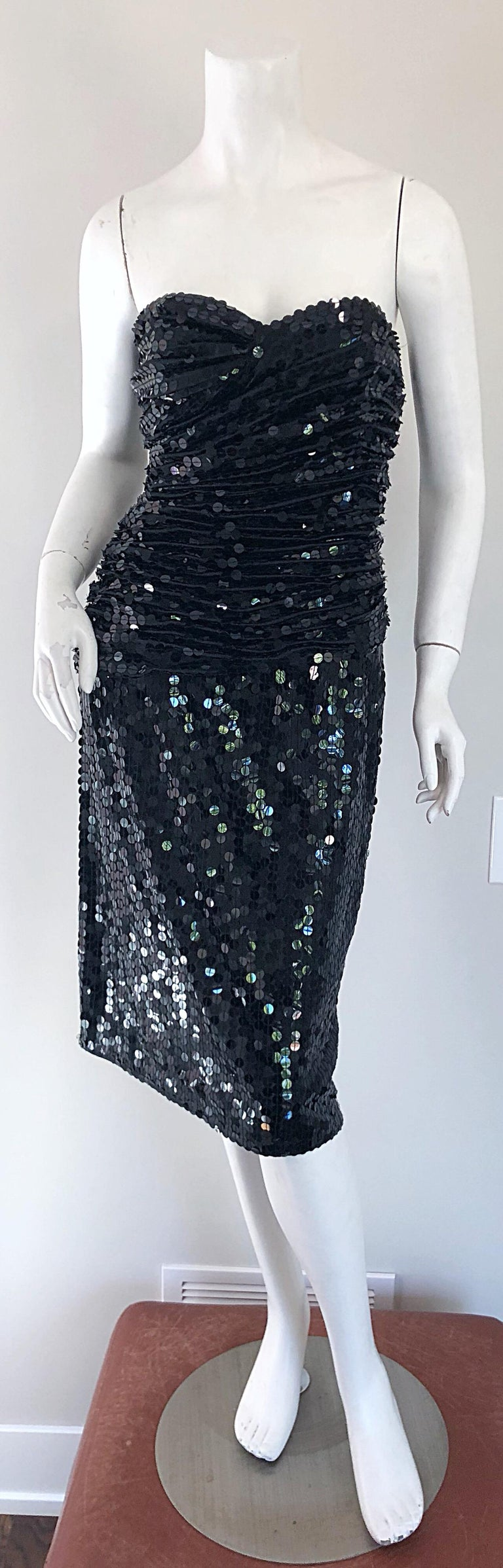 Stunning vintage VICKY TIEL COUTURE black silk strapless cocktail dress! Features thousands of hand-sewn black sequins throughout. Flattering ruched boned bodice offers plenty of stretch. Flirty skirt is perfect for dancing! Hidden zipper up the