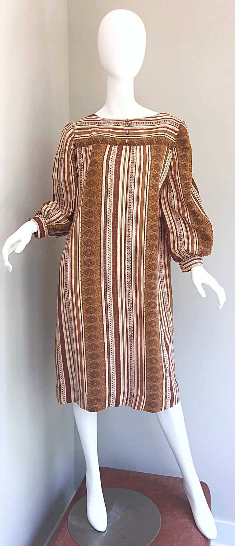 Boho chic brown, tan and ivory cotton sac dress! Reminiscent of the Yves Saint Laurent 1976 Russian Collection, this easy to wear gem is both stylish and comfortable. Features three mock buttons at center neck. Simply slips over the head. Great