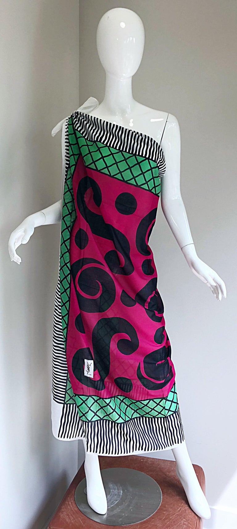 Iconic vintage YSL Yves Saint Laurent lightweight cotton jumbo shawl scarf / parero! Iconic question mark print in vibrant tones of raspberry, black green and white. Can be worn draped across the shoulders, as a wrap skirt, or belted as a one