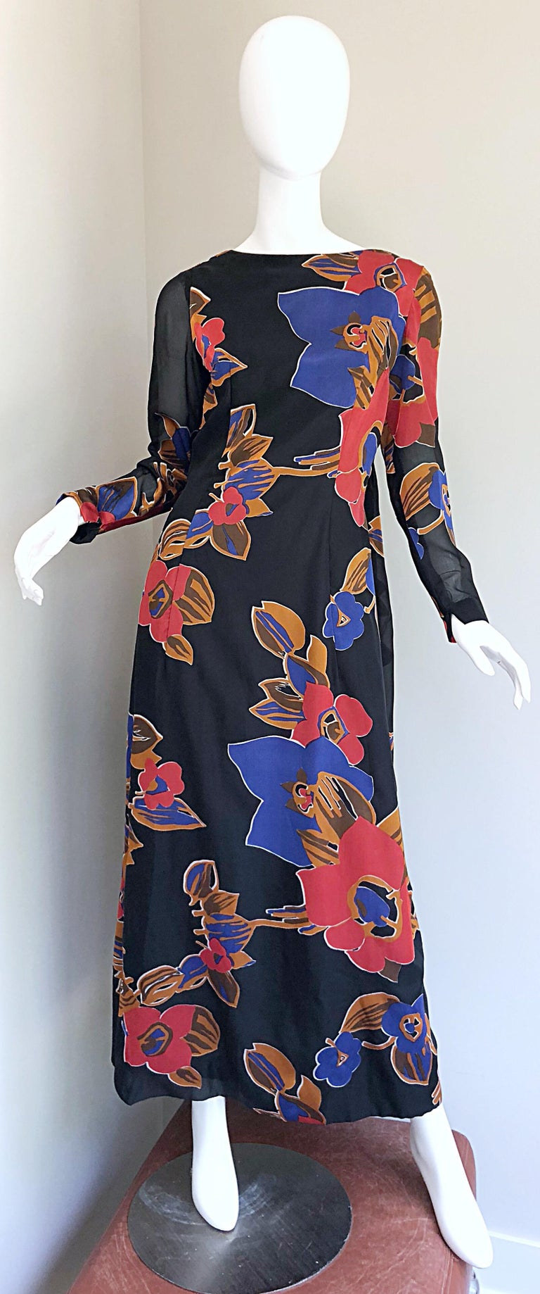 Fabulous 1960s JOHN BOYLE BISHOP black, red and terra cotta brown silk trained gown! Features an elegant high neck with a dramatic cape-like train in the back. Semi sheer patterned sleeves. Full metal zipper up the back with hook-and-eye closure.