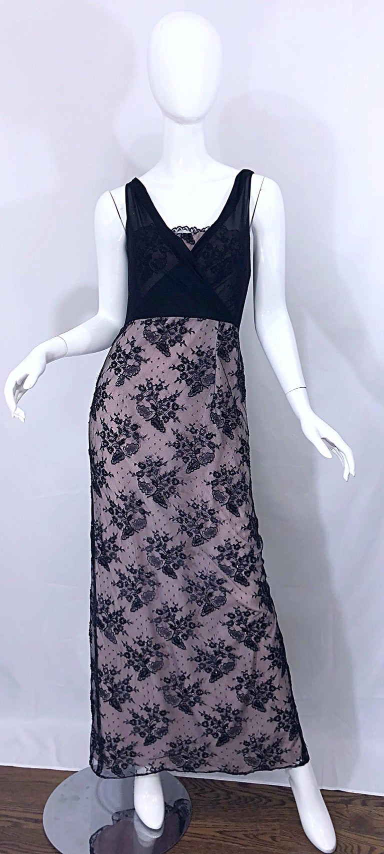 Gorgeous vintage BOB MACKIE black and pink beaded French lace evening gown! Features a light pink taffeta underlay. Black French lace covers the pink, and a semi sheer black chiffon bodice. Hidden zipper up the back with hook-and-eye closure.