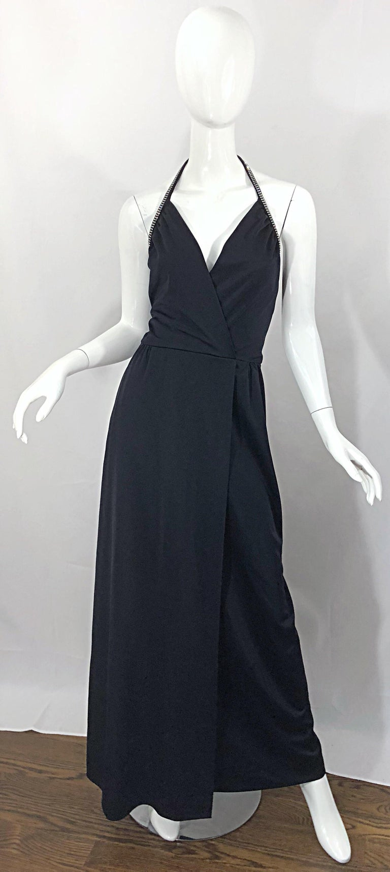 Sexy, yet classic 1970s LILLI DIAMOND black jersey rhinestone encrusted faux wrap jersey plunging Grecian halter gown / maxi dress! Features a fitted crossover bodice with a flattering and forgiving full skirt. Wonderful soft jersey fabric stretches